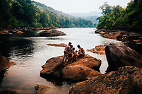 Fishermen near the waterfall on the Tatai river in Koh Kong, Cambodia.