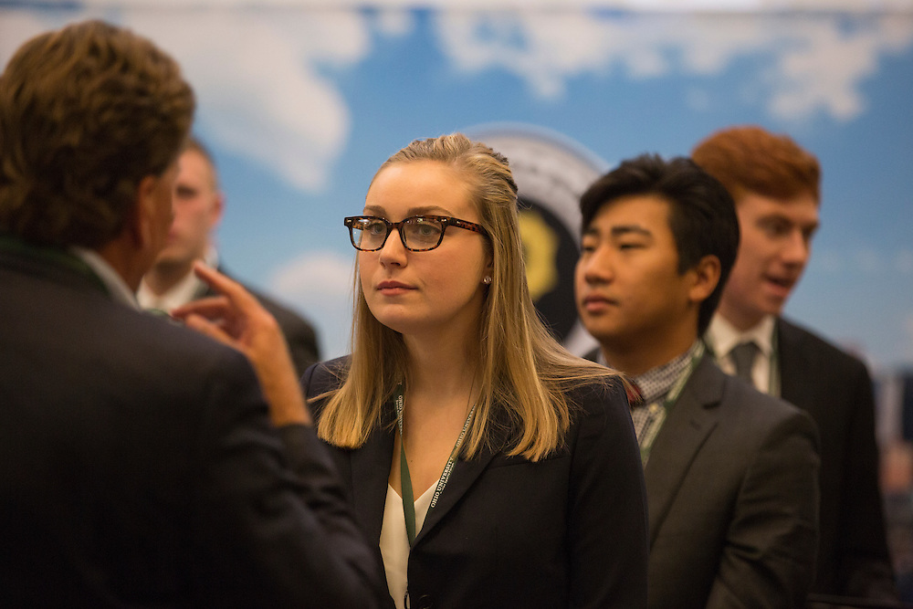 Allison Holtman, a College of Business student studying Finance and Sports Management, talks with Dan Crowther, the Director of Marketing for Hurricane Junior Golf Tour, at the Career Fair in Baker Ballroom on October 13, 2016.