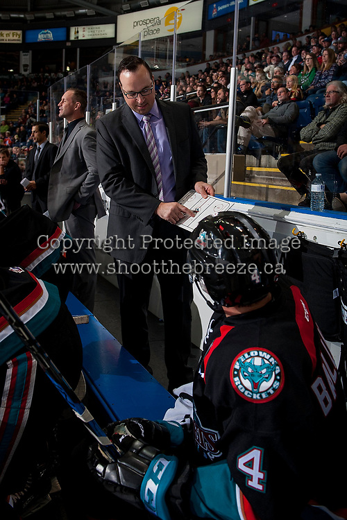 KELOWNA, CANADA - OCTOBER 4: Kelowna Rockets' assistant coach Kris Mallette goes over a play on the bench against the Victoria Royals on October 4, 2017 at Prospera Place in Kelowna, British Columbia, Canada.  (Photo by Marissa Baecker/Shoot the Breeze)  *** Local Caption ***