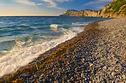 Morning light on rocky shoreline and ciffs along the Atlantic coastline<br /> , Forillon National Park, Quebec, Canada
