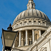 The dome of St Pauls Cathedral in London with street lamp.