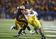 October 10, 2009: Michigan running back Brandon Minor (4) is hit by Iowa linebacker Pat Angerer (43) during the first half of the Iowa Hawkeyes' 30-28 win over the Michigan Wolverine's at Kinnick Stadium in Iowa City, Iowa on October 10, 2009.