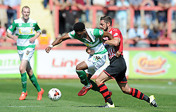 Yeovil Town's Sean Jeffers is tackled by Exeter City's Jamie McAllister - Photo mandatory by-line: Harry Trump/JMP - Mobile: 07966 386802 - 08/08/15 - SPORT - FOOTBALL - Sky Bet League Two - Exeter City v Yeovil Town - St James Park, Exeter, England.
