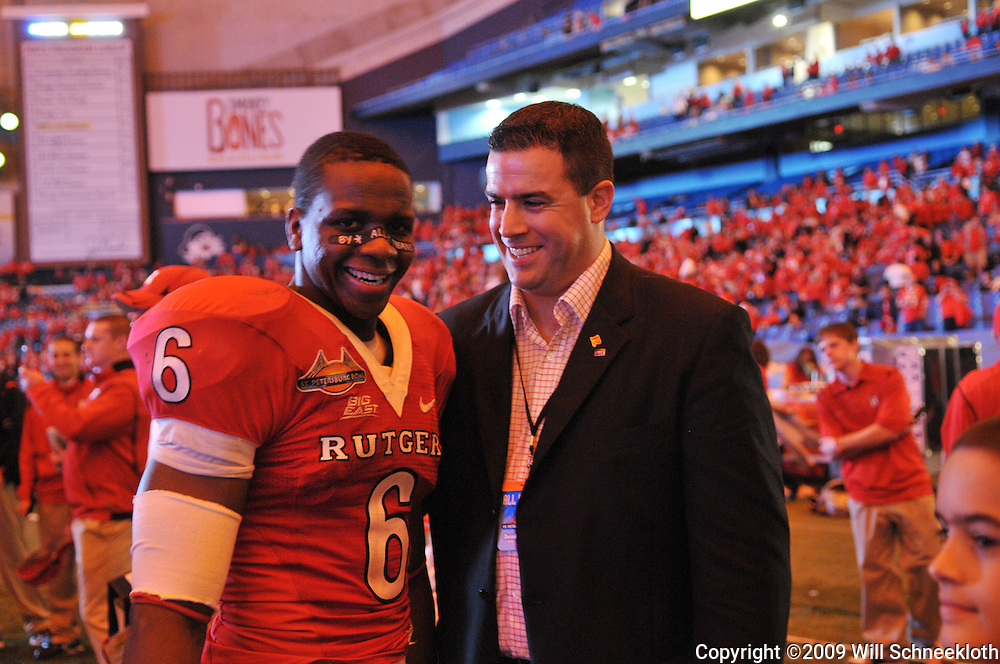 Dec 20, 2009; St. Petersburg, Fla., USA; Rutgers wide receiver Mohamed Sanu (6) celebrates being named Rutgers' most outstanding player with athletic director Tim Pernetti following Rutgers' 45-24 victory over Central Florida in the St. Petersburg Bowl at Tropicana Field.