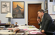 Representative Bruce Braley (D-IA) talks on the phone to a reporter in his office in the Rayburn House Office Building in Washington, DC on Wednesday, April 10, 2013.