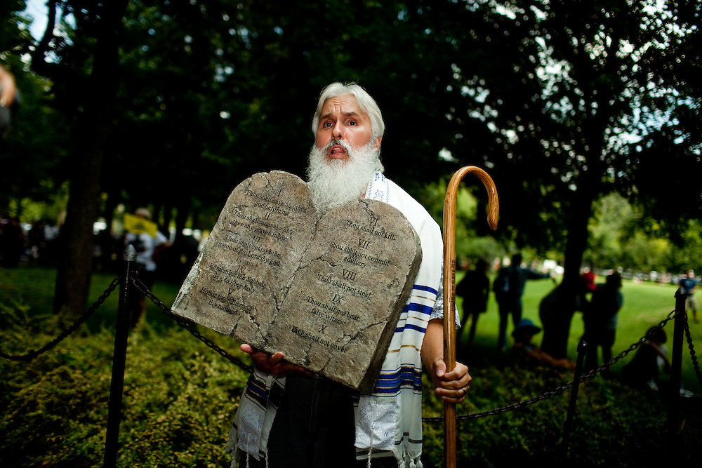 A man dressed as Moses preaches Bible verses during the 'Restoring Honor' event at the Lincoln Memorial on August 28, 2010 in Washington, DC.