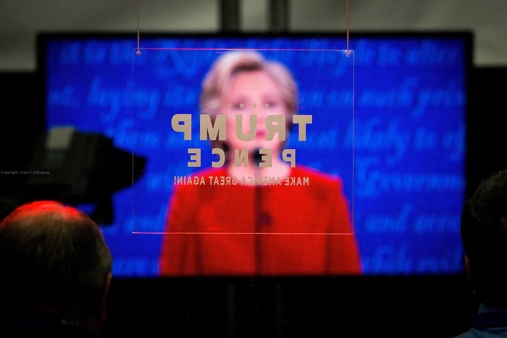 Reporters listen to Hillary Clinton at the debate. The Democrate and Republican nominees for US President, Hillary Rodham Clinton and Donald John Trump, met on Sep. 26th for the first head to head Presidential Debate at the Hofstra University in Long Island.