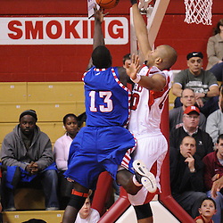 Jan 31, 2009; Piscataway, NJ, USA; Rutgers forward Gregory Echenique (00) blocks a shot by DePaul center Mac Koshwal (13) during the first half of Rutgers' 75-56 victory over DePaul in NCAA college basketball at the Louis Brown Athletic Center