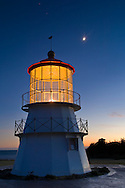 Crescent Moon over owl on the Cape Mendocino Lighthouse in evening light, Shelter Cove, Lost Coast, Humboldt County, California