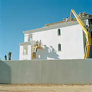 Murcia, Spain. From a story on the explosion of controversial golf resorts in Spain's arid south-east. These walled developments are often built on former farming land when farmers sell their land to the big developers. Most of these new houses are sold to foreign buyers as holiday homes..Photo shows the Polaris World La Torre Golf Resort which is under construction in Murcia, Spain..Photo©Steve Forrest/Amaya Roman