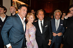 Left to right, ANDRE BALAZS, KYLIE MINOGUE, VALENTINO GARAVANI and GIANCARLO GIAMMETTI at a party to celebrate the launch of the Maison Assouline Flagship Store at 196a Piccadilly, London on 28th October 2014.  During the evening Valentino signed copies of his new book - At The Emperor's Table.