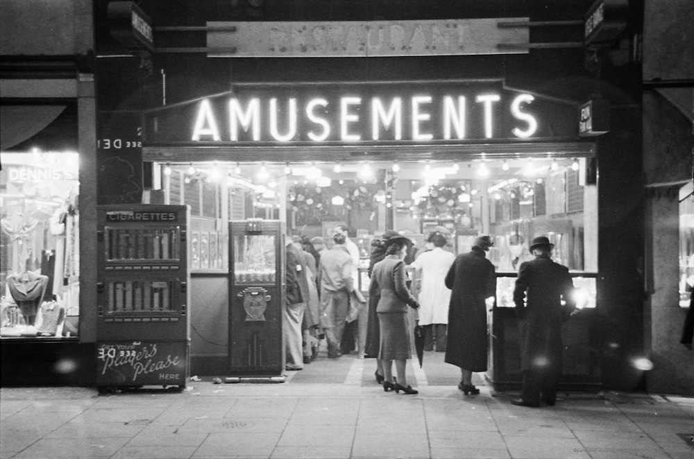 Scene in an amusement arcade, England, c. 1935