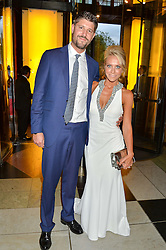 TV presenter LAURA HAMILTON and husband ALEX GOWARD at the Revlon Choose Love Masquerade Ball held at the V&A Museum, Cromwell Road, London on 21st July 2016.