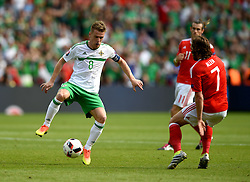Steven Davis of Northern Ireland battles for the ball with, Joe Allen of Wales  - Mandatory by-line: Joe Meredith/JMP - 25/06/2016 - FOOTBALL - Parc des Princes - Paris, France - Wales v Northern Ireland - UEFA European Championship Round of 16