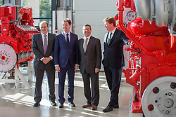 © Licensed to London News Pictures . 16/10/2014 . Stockport , UK . L-R Ed Davey ( Secretary of State for Energy and Climate Change ) , Nick Clegg ( Deputy Prime Minister ) , Mark Hunter ( Liberal Democrat MP for Cheadle ) and Danny Alexander ( Chief Secretary to the Treasury ) at the MAN Diesel factory in Stockport after a cabinet meeting of the Local Growth Committee , held at the plant . Photo credit : Joel Goodman/LNP