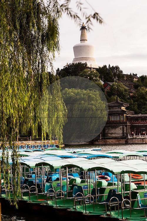 View at sunset of the White Dagoba Tibetan style stupa in Beihai Park in Beijing, China