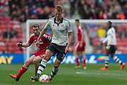 Fulham defender Dan Burn in possession watched by Middlesbrough FC midfielder Grant Leadbitter during the Sky Bet Championship match between Middlesbrough and Fulham at the Riverside Stadium, Middlesbrough, England on 17 October 2015. Photo by George Ledger.