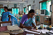 Sister Krishna Mondal writes in the patient's medical notes. She is the senior nurse who manages the CINI emergency ward. Child In Need Institute (CINI) is based in Kolkata, India. It is a non-governmental organisation (NGO), which provides sustainable development in health, nutrition, education and security for the poorest communities in West Bengal, Jharkhand, Chattisgarh and Madhya Pradesh states.