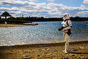 Kevin Skiera stands on the beach dressed as an Imperial Stormtrooper from the film Star Wars during the Crystal Lake Centennial Kick-Off Festival at Three Oaks Recreation Area in Crystal Lake, Ill., Saturday, Sept. 21, 2013.
