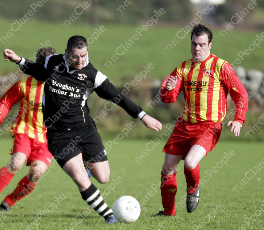 Moher's Sam Madigan and Avenue's Ronan Ryan in action during their game in Liscannor at the weekend.<br />