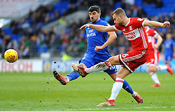 Ben Gibson of Middlesbrough is challenged by Callum Paterson of Cardiff City - Mandatory by-line: Nizaam Jones/JMP - 17/02/2018 -  FOOTBALL - Cardiff City Stadium - Cardiff, Wales -  Cardiff City v Middlesbrough - Sky Bet Championship