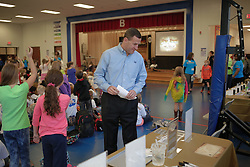 PPG Architectural Coatings division hosted an event featuring ION Jones, a character who teaches students about Chemistry. Tom Maziarz with PPG introduced the program led by Jonathan , Friday, Oct. 24, 2014 at Bloom Elementary School in Louisville.