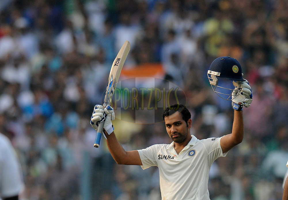 Rohit Sharma of India celebrates after scoring a century on his debut match  during day two of the first Star Sports test match between India and The West Indies held at The Eden Gardens Stadium in Kolkata, India on the 7th November 2013<br /> <br /> Photo by: Pal Pillai - BCCI - SPORTZPICS
