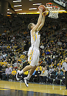 February 2 2011: Iowa Hawkeyes guard Matt Gatens (5) puts up a shot during the first half of an NCAA college basketball game at Carver-Hawkeye Arena in Iowa City, Iowa on February 2, 2011. Iowa defeated Michigan State 72-52.