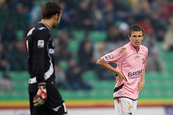 Goalkeeper Samir Handanovic of Udinese and Josip Ilicic of Palermo during football match between Udinese Calcio and Palermo in 8th Round of Italian Seria A league, on October 24, 2010 at Stadium Friuli, Udine, Italy.  Udinese defeated Palermo 2 - 1. (Photo By Vid Ponikvar / Sportida.com)