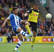 Picture by David Horn/Focus Images Ltd +44 7545 970036<br /> 28/09/2013<br /> Troy Deeney of Watford (right) and Ryan Shotton of Wigan Athletic (left) during the Sky Bet Championship match at Vicarage Road, Watford.
