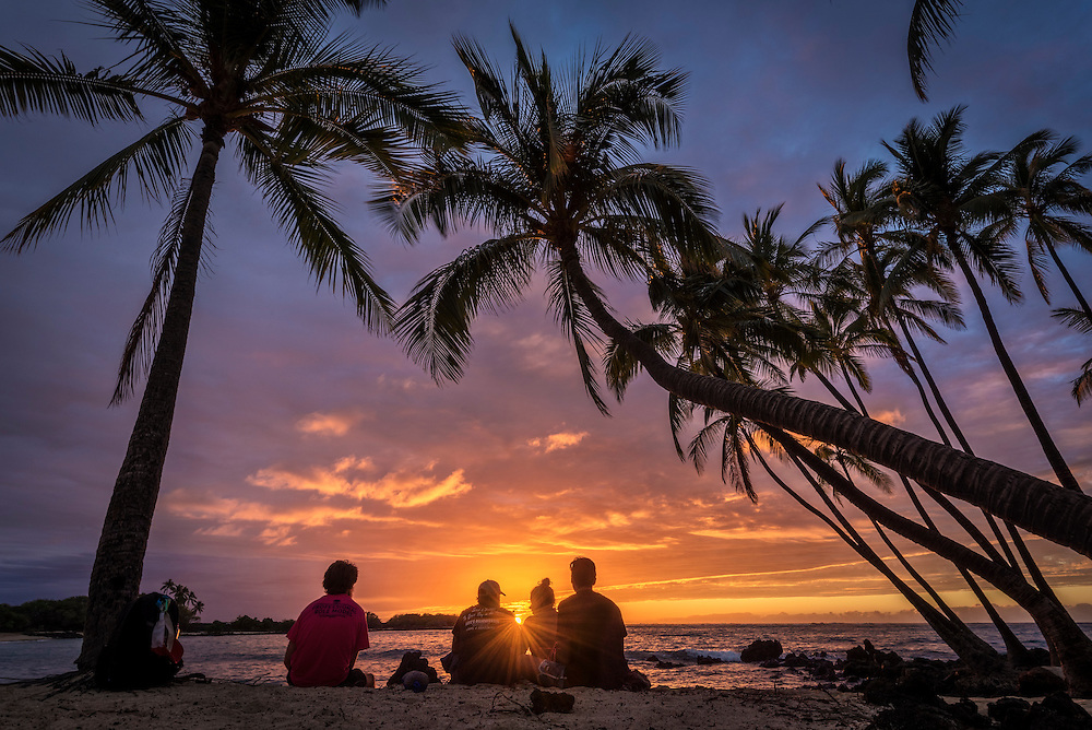 Sunset and coconut palm trees at Makalawena Beach, Kekaha Kai State Park, Kona-Kohala Coast, Big Island of Hawaii.