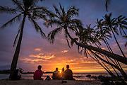 Sunset and coconut palm trees at Makalawena Beach, Kekaha Kai State Park, Kona-Kohala Coast, Big Island of Hawaii.