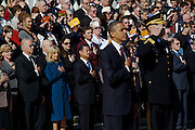 ARLINGTON, VA - NOVEMBER 11: U.S. Vice President Joe Biden (L) and his wife, Dr. Jill Biden, stand with their hands over their hearts for the National Anthem after U.S. President Barack Obama laid a wreath in front of the Tomb of the Unknowns on Veteran's Day at Arlington National Cemetery on November 11, 2012 in Arlington, Virginia.
