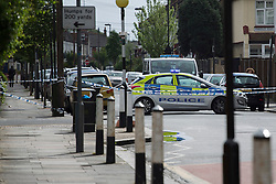 © licensed to London News Pictures. London, UK 11/05/2013. Police officer investigating a crime scene where a man found stabbed on Tottenham High Road. The man reported to be in a critical condition and seven people have been arrested. Photo credit: Tolga Akmen/LNP