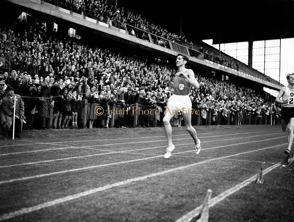 R Delany beating D Ibbotson at Landsdowne Rd..29/07/1957..George Derek Ibbotson MBE (born June 17, 1932 in Huddersfield, West Riding of Yorkshire, England) was an English runner who excelled in athletics in the 1950s. His most famous achievement was setting a new world record in the mile in 1957..Ibbotson was born in Huddersfield and studied at King James's Grammar School in Almondbury. He was of the generation that included other great British milers such as Roger Bannister, Chris Brasher and Christopher Chataway. He was the junior champion in Britain in 1951..After service in the Royal Air Force, Ibbotson returned to competition. In 1956 at Melbourne, he won a bronze medal in the 5,000 meters. After the Games, Ibbotson focused on the mile run, which was probably an error. Ibbotson began the 1957 season running in mile races, as a 5000m or 3 mile runner would often do in the early part of the facing season - to race at a faster pace than he would need in those longer distances. After he had run a particularly fast mile at a Glasgow, an experienced athletics official told the BBC that while it was a very good time, he and many others felt that Ibbotson's greater potential was over 5000m or 3 miles. Unfortunately, somebody then organised one of the many ?miles of the century? and Ibbotson won, probably because Delaney, the 1500m champion at Melbourne the previous year, was boxed in at a crucial point on the final lap. The time was a new world record, taking .8 of a second off John Landy's time of 3.58min set in 1954. The result was that Ibbotson went on running in mile races throughout the season - although also taking part in some longer distance events - and he ran a great number of races and ended the season exhausted. It was not just the number of races but the faster pace at which they were run..Ibbotson never found the same form again...Ronald Michael Delany (06/03/1935), better known as Ron or Ronnie is a former Irish athlete, who specialised in middle distanc