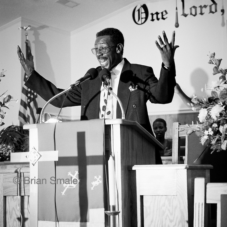 Rev. Jonathan Mouzon, of the Macedonia Baptist Church, which was burned by members of the CKKK (K.K.K.) (Christian Knights of the Ku Klux Klan).  Photographed by Brian Smale for Spin Magazine.