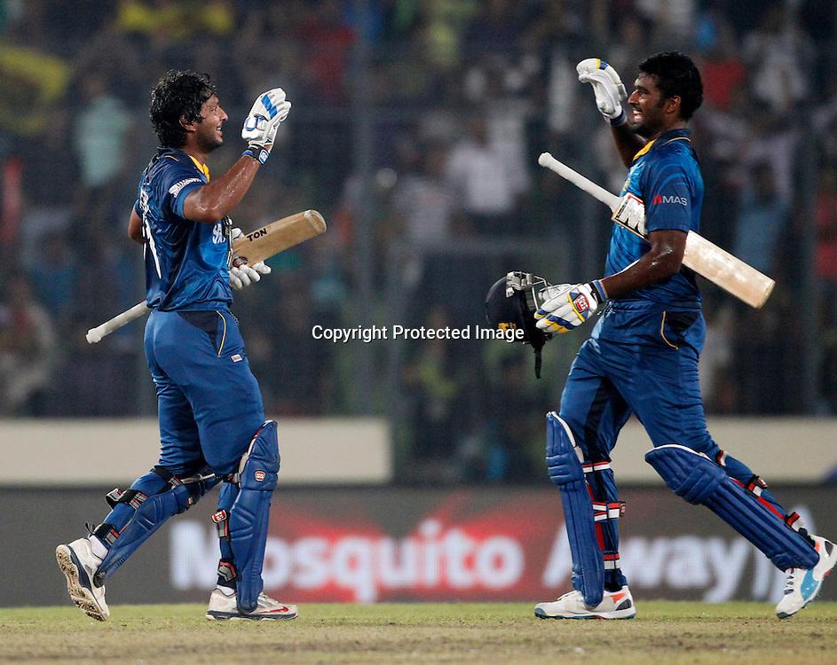 Kumar Sangakkara and Thisara Perera celebrate the win, ICC T20 cricket World Cup Final - Sri Lanka v India, Sher-e-Bangla National Cricket Stadium, Mirpur, Bangladesh, 6 April 2014. Photo: www.photosport.co.nz