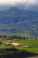 A view of the medieval tower and fortress of Radicofani as seen from the hamlet known as La Foce nearby Montepulciano in Tuscany, Italy