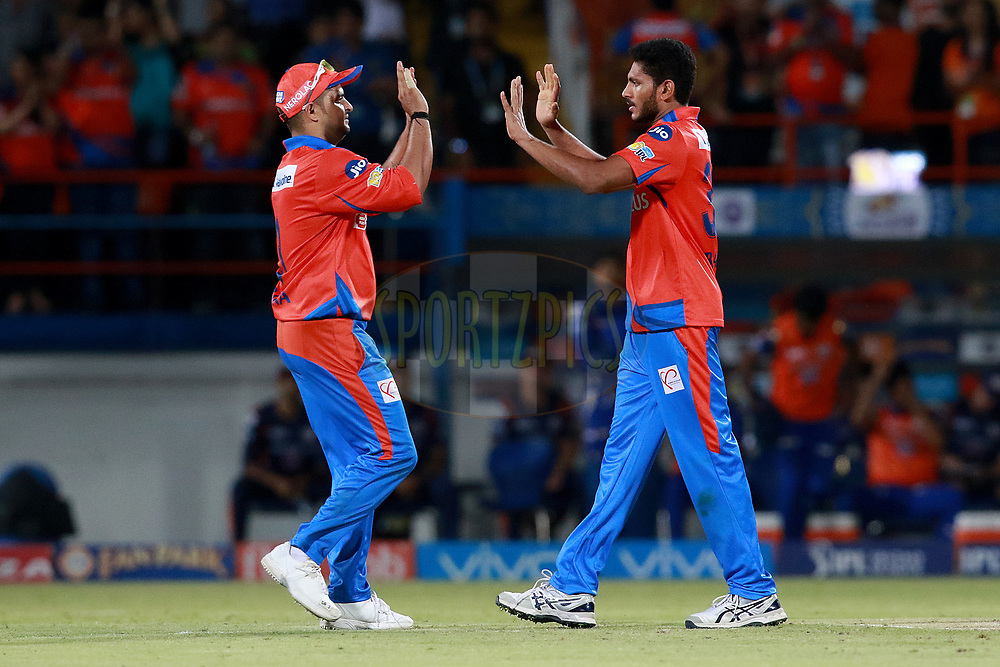 Basil Thampi of GL celebrates after takes a wicket of Hardik Pandya of MI during match 35 of the Vivo 2017 Indian Premier League between the Gujarat Lions and the Mumbai Indians  held at the Saurashtra Cricket Association Stadium in Rajkot, India on the 29th April 2017<br /> <br /> Photo by Rahul Gulati - Sportzpics - IPL