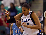 Duke Senior Center Krystal Thomas acknowledges a great pass during their 81 - 66 win over North Carolina during the Championship Game of the 2011 ACC Women's Basketball Tournament held at the Greensboro Coliseum in Greensboro, North Carolina.  (Photo by Mark W. Sutton)