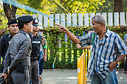 "01 FEBRUARY 2014 - BANGKOK, THAILAND: A Thai man tries to get past police lines to go to his polling place in the Din Daeng area of Bangkok. Thais went to the polls in a ""snap election"" Sunday called in December after Prime Minister Yingluck Shinawatra dissolved the parliament in the face of large anti-government protests in Bangkok. The anti-government opposition, led by the People's Democratic Reform Committee (PDRC), called for a boycott of the election and threatened to disrupt voting. Many polling places in Bangkok were closed by protestors who blocked access to the polls or distribution of ballots. The result of the election are likely to be contested in the Thai Constitutional Court and may be invalidated because there won't be quorum in the Thai parliament.    PHOTO BY JACK KURTZ"