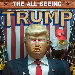 "© Licensed to London News Pictures. 27/03/2018. LONDON, UK. ""All Seeing Trump Machine"", US, 2016, launched a month before the 2017 US Presidential election, this 'misfortune' gave voters a taste of Trump as President.  Preview of ""Hope to Nope: Graphics and Politics 2008-18"", an exhibition examining the political graphic design of a turbulent decade encompassing the 2008 financial crash, Barack Obam presidency, Brexit and Donald Trump's presidency.  The exhibition takes place at the Design Museum 28 March to 12 August 2018.  Photo credit: Stephen Chung/LNP"