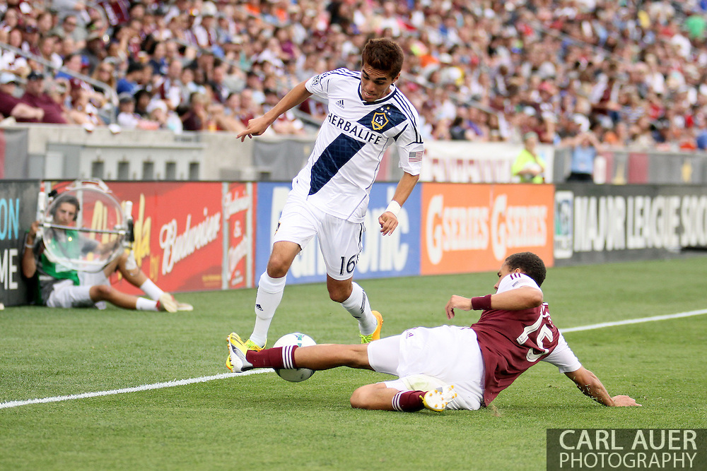 July 27th, 2013 - LA Galaxy midfielder Hector Jimenez (16) attempts to push the ball through the slide tackle by Colorado Rapids defender Chris Klute (15) in the second half of action in the Major League Soccer match between the LA Galaxy and the Colorado Rapids at Dick's Sporting Goods Park in Commerce City, CO