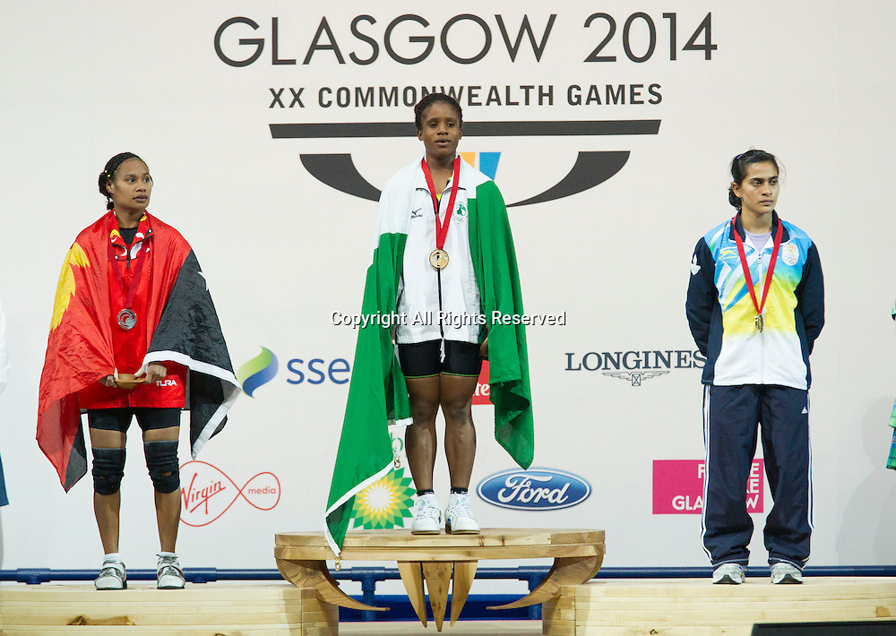 25.07.2014. Glasgow, Scotland. Glasgow Commonwealth Games. Women's 53kg Final. L-R Kika Toua of PNG who came 2nd Winner Chika Amalaha of NGR and 2nd places Santoshi Singh of IND.