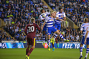 Reading Defender, Jordan Obita (11) Reading Defender, Paul McShane (5) Reading Forward, Yann Kermorgant (18) defend a Ipswich trow in during the EFL Sky Bet Championship match between Reading and Ipswich Town at the Madejski Stadium, Reading, England on 9 September 2016. Photo by Adam Rivers.