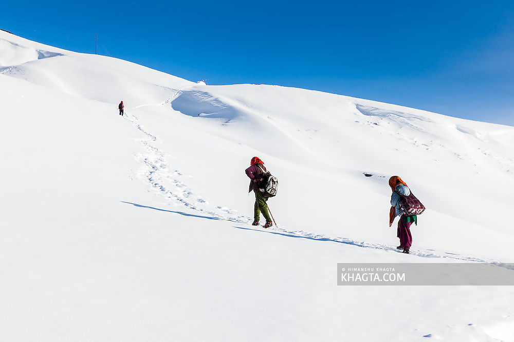 In the mid of March, two girls accompanied by their mother going back home in Komic village to enjoy their after exam holidays in their school in Rangrik village. As the roads are covered with more than four feet of snowfall, the locals take this route from Kaza to reach Komic in winter and spring season.