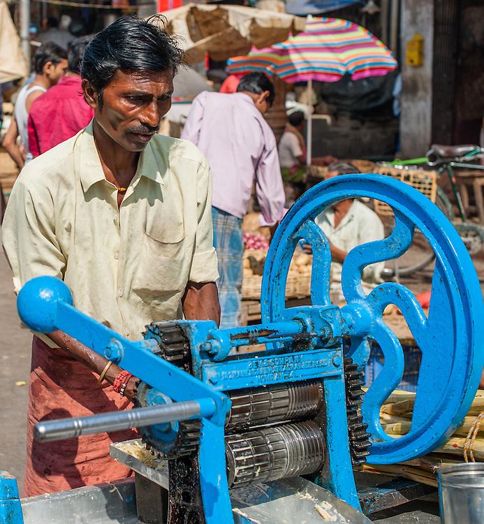 Sugarcane juice seller (India)