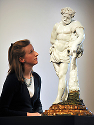 © Licensed to London News Pictures. 01/12/2011, London, UK.  ABonhams employee look at  a very rare 82cm high porcelain figure of Hercules created at the Doccia factory in Tuscany in 1753-55 is to be sold at Bonhams, New Bond Street, London on 7th December 2011.  This is the first time that a Doccia figure of this size has come to auction and the piece is estimated to sell for £300,000-500,000.. Photo credit : Stephen Simpson/LNP
