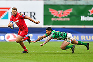 Scarlets' Paul Asquith escapes the tackle of Benetton Treviso's Monty Ioane<br /> <br /> Photographer Simon King/Replay Images<br /> <br /> EPCR Champions Cup Round 3 - Scarlets v Benetton Rugby - Saturday 9th December 2017 - Parc y Scarlets - Llanelli<br /> <br /> World Copyright © 2017 Replay Images. All rights reserved. info@replayimages.co.uk - www.replayimages.co.uk