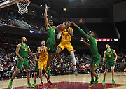 Feb 21, 2019; Los Angeles, CA, USA; Southern California Trojans guard Shaqquan Aaron (0) is defended by \o14] and forward Louis King (2) in the second half  at Galen Center. USC defeated Oregon 66-49.
